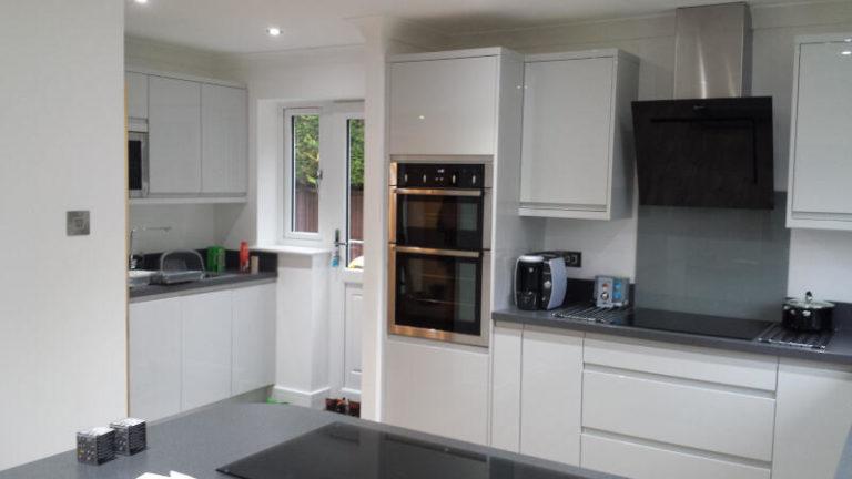 Custom white modern kitchen installation with modern appliances