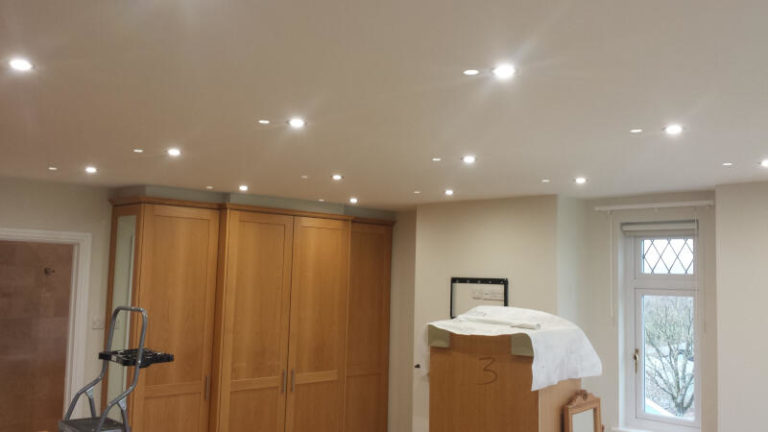 Custom interior ceiling spotlights turned on
