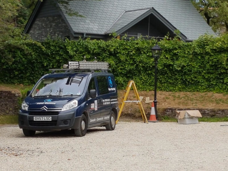 D Fisher Electrical van parked on gravel drive